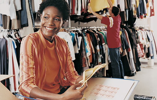 Smiling woman in a clothing venture.