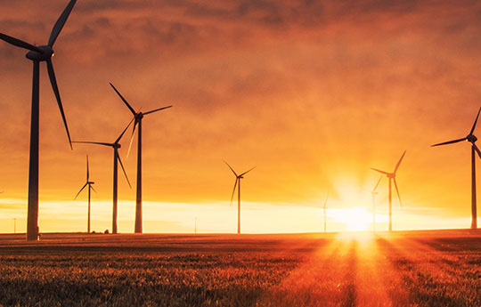 wind energy with sunset landscape